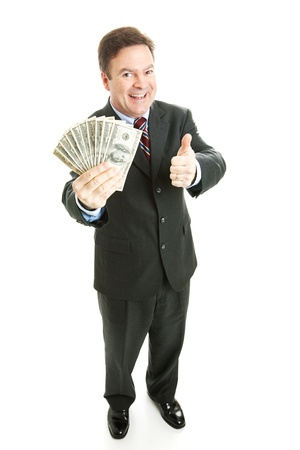 Successful businesman holding a wad of cash in hundred dollar bills.  Full body isolated on white.   photo