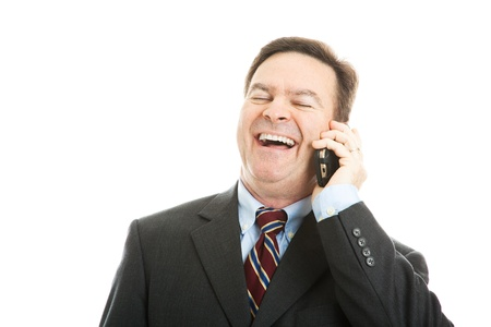voicemail: Fortyish businessman laughing as he talks on his cellphone.  Isolated on white.