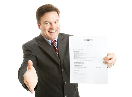 Confident businessman, ready with his resume, a smile, and a handshake.  Isolated on white.  (info on resume is all made up, and totally generic) Stock Photo
