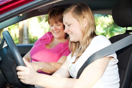 Teenage girl eager to start a driving lesson with her mother or an instructor.   photo
