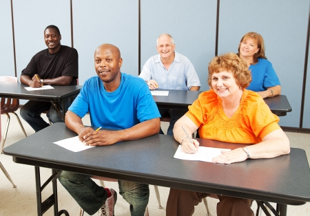 overweight students: Diverse adult education class, various ages and ethnicities, smiling and happy.