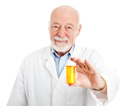 Friendly pharmacist holding a bottle of pills.  Isolated on white.   photo