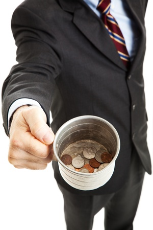 Businessman begging for change in his tin cup.  White background.   Stock Photo