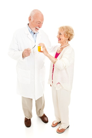 Senior woman questions her trusted pharmacist about medication.  Full body isolated on white.   photo