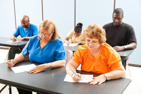 Diverse adult education or college class taking a test.   Stock Photo - 12165810