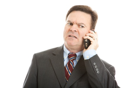 voicemail: Businessman talking on his cellphone.  Very expressive worried face.  Isolated on white.   Stock Photo