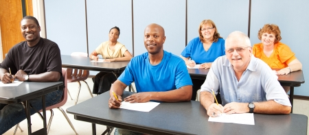 university classroom: Diverse adult education or college class.  Wide angle banner.   Stock Photo