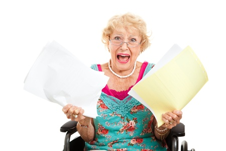 medical bill: Disabled senior woman screaming in frustration about her medical bills.  Isolated on white.   Stock Photo