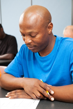 classroom training: Handsome African-american college student taking a test.