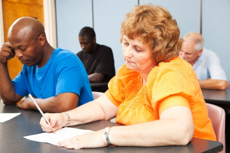 Mature woman in diverse adult education class. photo