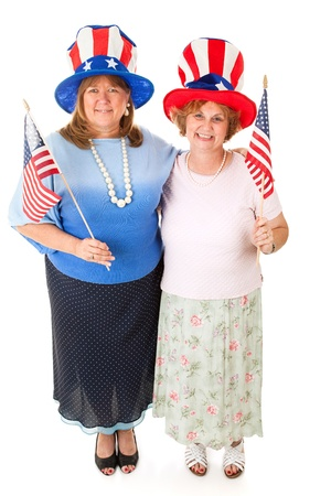 A couple of patriotic Tea Party conservative voters.  Full body isolated on white.   Stock Photo - 13248681