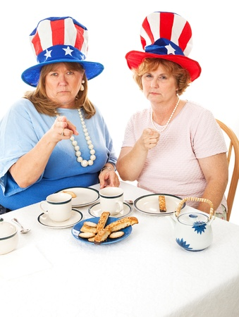 voters: Two angry conservative voters having an actual tea party.  White background.  Room for text at the bottom of frame.