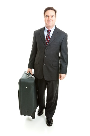 Full body isolated view of a businessman traveling with his suitcase. Stock Photo - 13248618