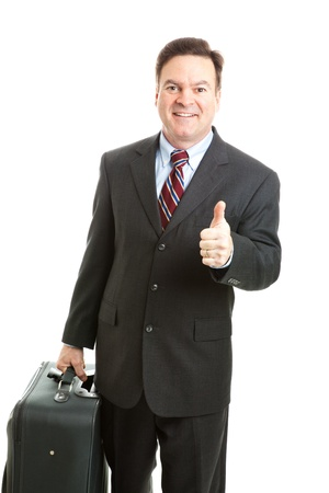 Businessman traveling with his suitcase, giving a thumbs up sign.  Isolated on white.