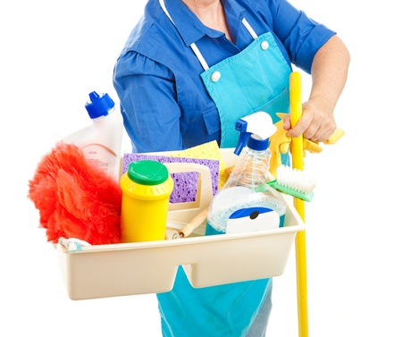 Maid holding cleaning supplies.  White background.   photo