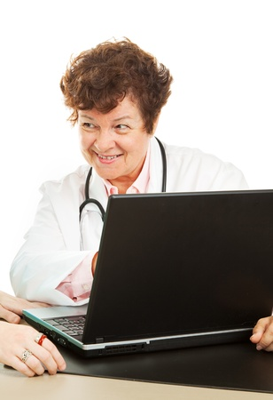 Female doctor showing a patient her test results on the computer.  Isolated on white. photo