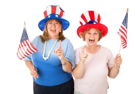 Enthusiastic American Tea Party voters in patriotic hats and holding flags.  Isolated on white.   photo