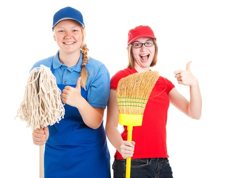 Enthusiastic teenage workers with their first jobs, giving thumbs up.  Isolated on white Stok Fotoğraf