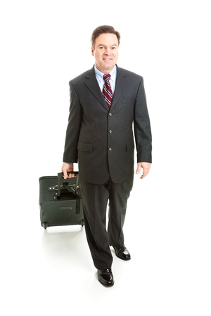 business traveler: Full body isolated view of a business traveler carrying his rolling suitcase.