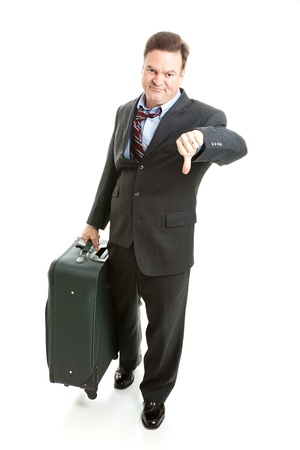 Dissatisfied business traveler giving thumbs down on his travel experience.   photo