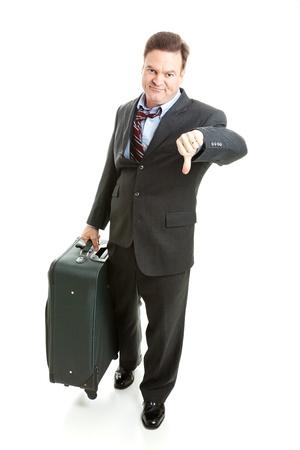 Ontevreden zakenreiziger geven thumbs neer op zijn reiservaring. Stockfoto