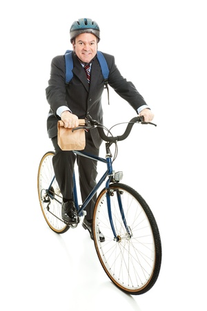 conscious: Environmentally conscious businessman rides a bicycle to work.  Full body isolated on white.   Stock Photo