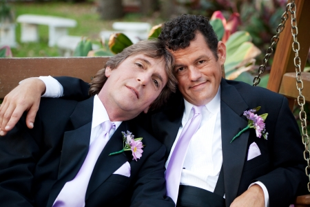gay marriage: Portrait of very handsome gay male couple on their wedding day.