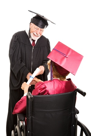 dean: Senior woman in wheelchair collects a diploma as she graduates.  Isolated on white.