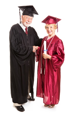 dean: Senior woman graduating and receiving her degree from the dean.  Isolated on white, full body.