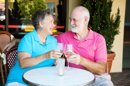 Senior couple on a romantic date, having cocktails at a restauraunt.   Stock Photo - 13736053