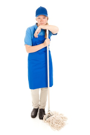 first job: Unhappy teenage girl, with her first job, leaning on a mop.  Full body isolated on white.   Stock Photo