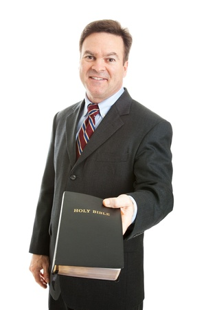 missionary: Christian businessman, minister, or missionary, holding a bible.  Isolated on white.