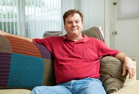 Mid adult caucasian man relaxing at home on the couch. photo