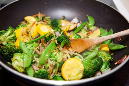 sautee: Healthy vegetable stir fry cooked in a Chinese style wok.