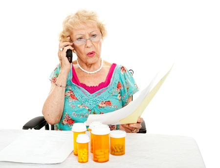 medicare: Disabled senior woman shocked by the cost of medical care and prescription medicine.
