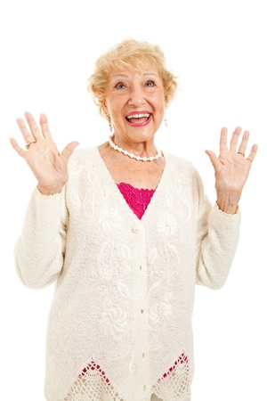 thankfulness: Senior woman raising her hands in praise, joy or surprise.    Stock Photo
