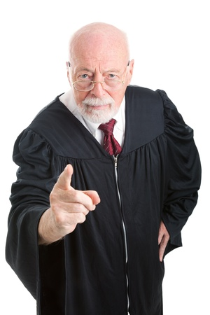ruling: Serious, stern judge pointing his finger at the camera   Isolated on white