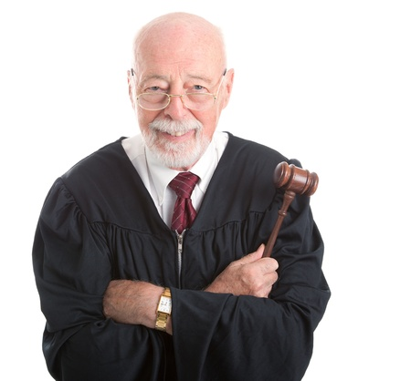 judges: Wise, kind looking judge holding his gavel   Isolated on white background