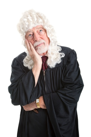British style judge wearing a wig and a bored expression   Isolated on white    Imagens