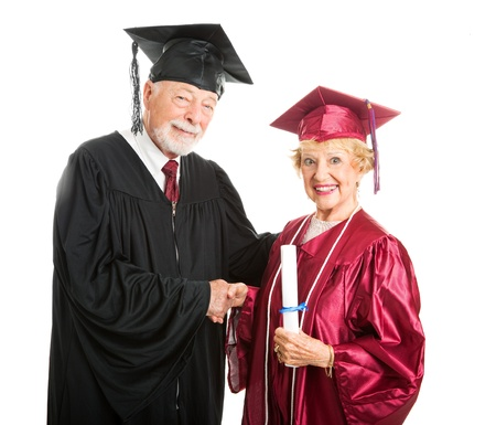 university professor: Senior woman receives her diploma at graduation ceremony   Isolated on white