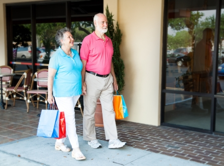 khaki pants: Senior couple shopping together at an outdoor mall    Stock Photo
