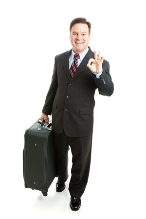 SATISFIED: Business traveler gives the A-Okay sign.  Full body isolated on white background.