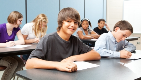public schools: Diverse group of adolescent school children in class.  Real kids in real classroom.   Stock Photo