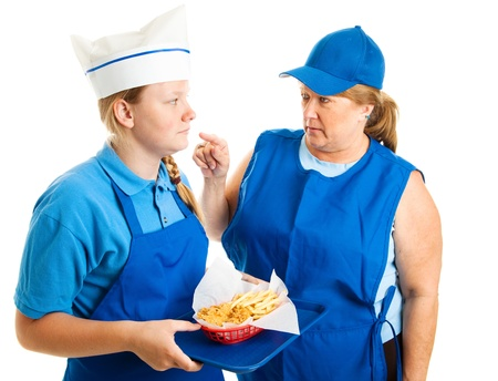 Teen girl working in fast food gets pushed around by her boss   Isolated on white