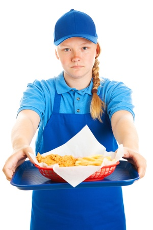 Serious teenage girl serving a fast food meal   Isolated on white