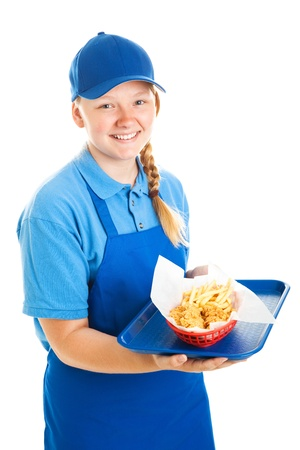 Teenage worker serving a fast food meal   Isolated on white    photo