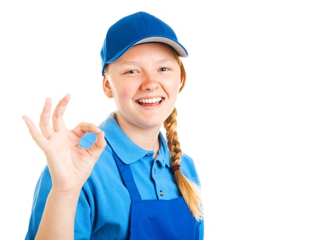 okay sign: Pretty blond teenage girl in a work uniform, giving the okay sign   Isolated on white