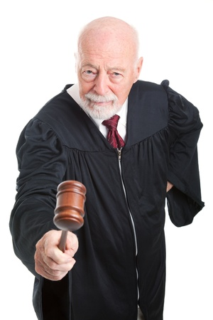 Angry judge bangs his gavel.  Isolated on white.   photo