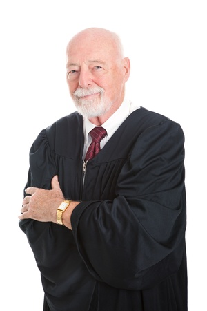 ruling: Handsome mature judge in his judicial robes, with his arms crossed.  Isolated on white.