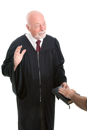 swearing: Judge swearing in a witness on the Holy Bible.  Isolated on white.   Stock Photo